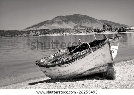 Abandoned fisherman boat on the shore of the Adriatic sea. - stock photo
