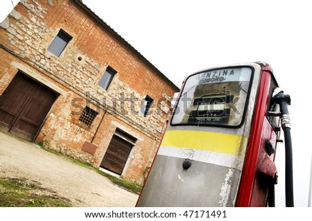 Abandoned gas pump in the italian countryside - stock photo
