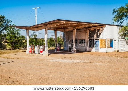 Abandoned gas station with a canopy and five gas pumps on Route 66 - stock photo