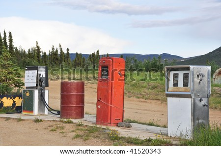 abandoned gasoline pumps - stock photo