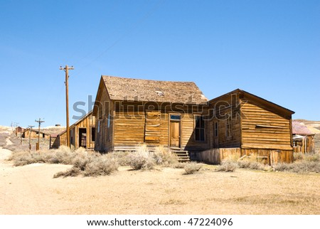 abandoned ghost town and dirt road - stock photo