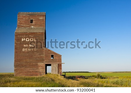 Abandoned grain elevator in the ghost town of Bents on the Canadian prairies - stock photo