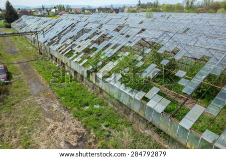 Abandoned greenhouses damaged and destroyed by the hail - stock photo