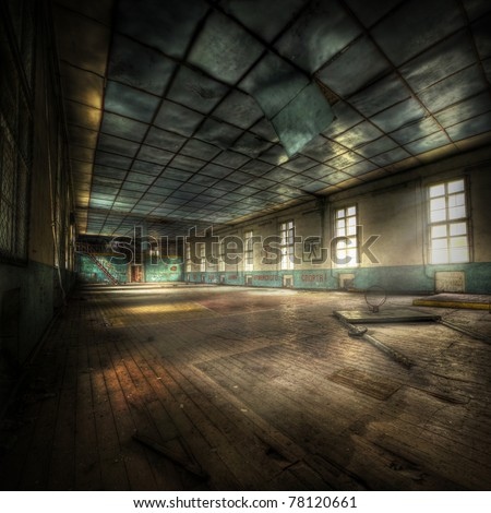 abandoned gym with cyrillic letters on the walls, hdr processing - stock photo