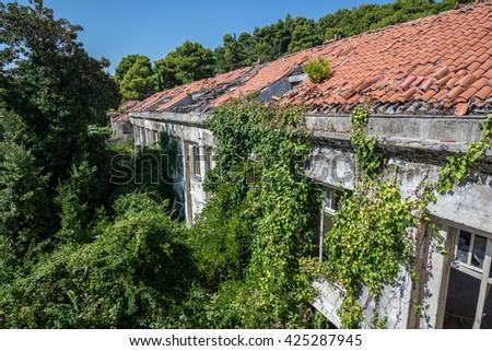 Abandoned hotel in former Tourist Complex of Kupari village in Croatia - stock photo