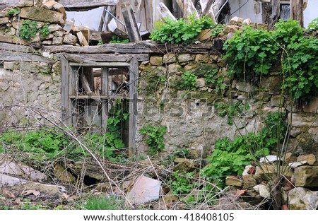 Abandoned house in the Bulgarian village in the springtime - stock photo