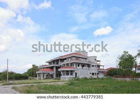 Abandoned house under blue sky - stock photo