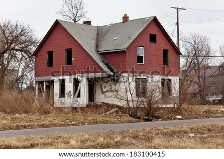 Abandoned houses in Detroit, Michigan. This is a deserted building in a bad part of town. - stock photo