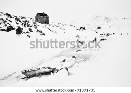 Abandoned houses in the Kulusuk village, Greenland, black and white tone picture - stock photo