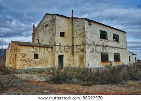 Abandoned industrial buildings - stock photo