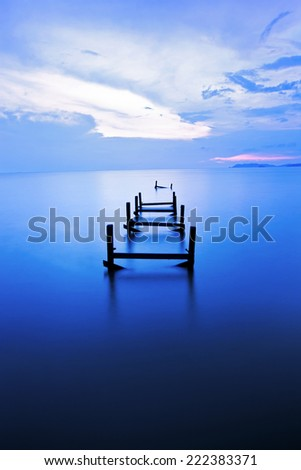 abandoned jetty with blue hour background - stock photo