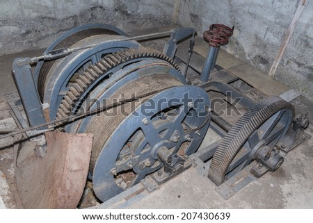 Abandoned lift in old mining shaft . - stock photo