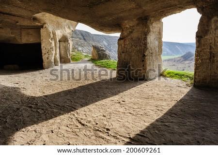 Abandoned limestone mines in Old Orhei, Moldova - stock photo
