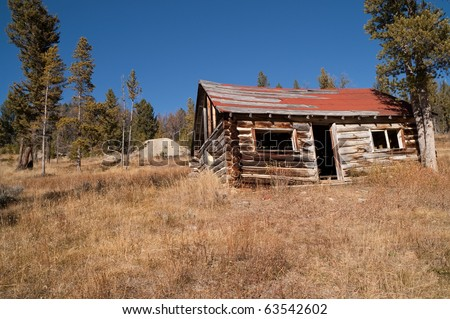 Abandoned log home in a Montana mining ghost town - stock photo