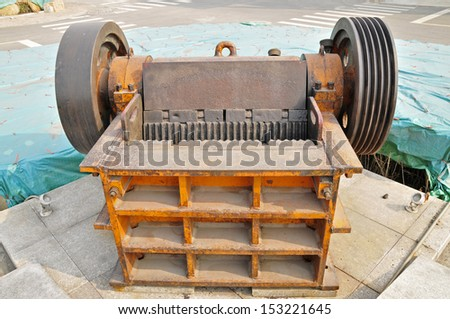 Abandoned machinery and wheels  - stock photo