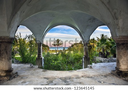 Abandoned mansion with an ocean front view. - stock photo