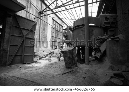 Abandoned metallurgical factory interior and building waiting for a demolition.Black & white style. - stock photo