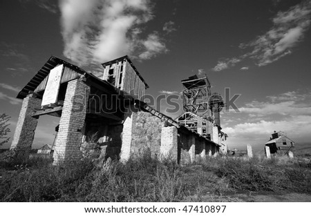 abandoned mill in black and white