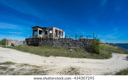 Abandoned mines and houses. Quarry and old prison cottage architecture. The ashes dunes in  Estonia, Europe.