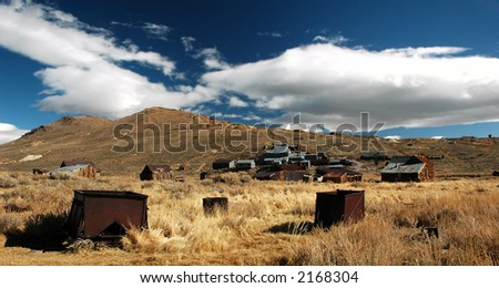 Abandoned mining cars and town in Bodie, California - stock photo