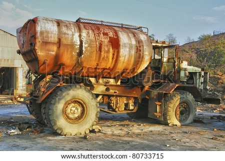 Abandoned mining huge industrial old truck, in Spain - stock photo