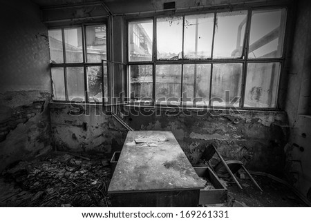 abandoned office at old factory black and white - stock photo