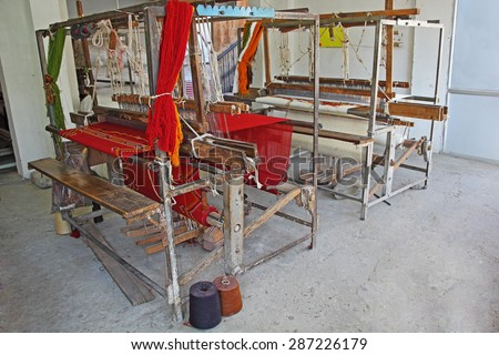 Abandoned old age handloom machine for making cloths and fabrics from India. Technological progress overtook manually operated machines like this. - stock photo
