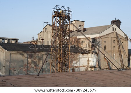 Abandoned old building with rusty iron constructions. View from the top. - stock photo