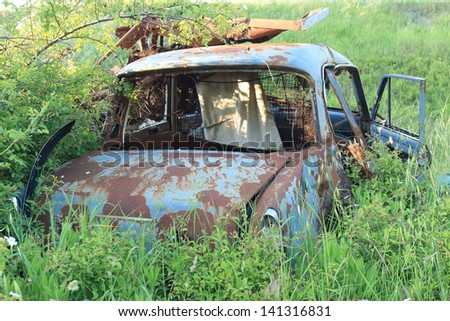 abandoned old car - stock photo