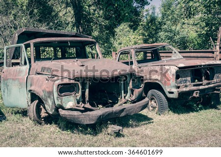 abandoned old car can use grunge scene vintage background - stock photo