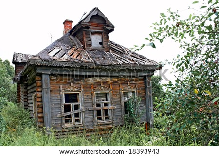 abandoned old house in russian village - stock photo