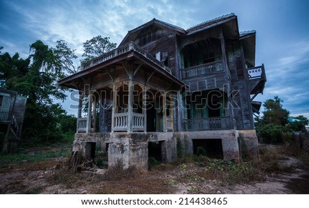 abandoned old house on twilight - stock photo