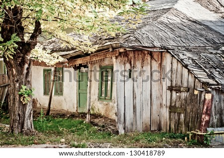 Abandoned old house. Traditional rural cottage decay. - stock photo