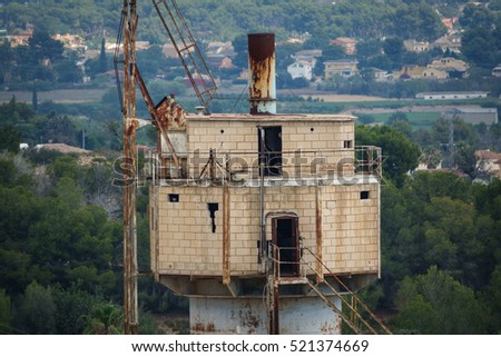 Abandoned old industrial tower in mine
