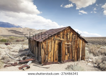 Abandoned old miner's cabin in Benton Hot Springs in the high desert of California. - stock photo