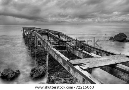 Abandoned old pier shot in black and white - stock photo