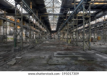 Abandoned old production hall with many plants and steel beams