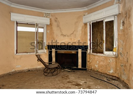 Abandoned old rocking chair, room in the house. - stock photo