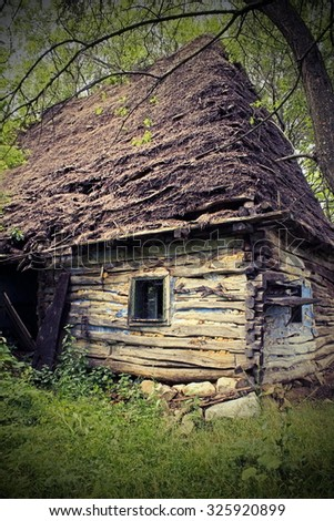 abandoned old traditional romanian mountain house with vignette, vintage look - stock photo