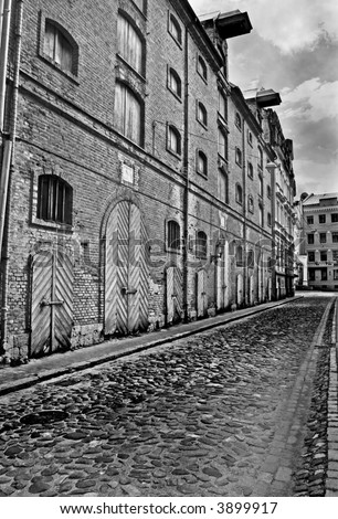 Abandoned old warehouse buildings. Black and white photo - stock photo