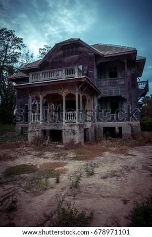 abandoned old wood house on twilight