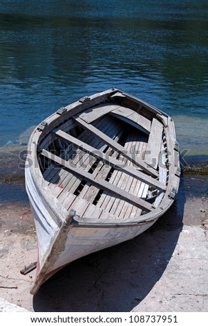 Abandoned old wooden boat at a Mediterranean sea(Greece) - stock photo