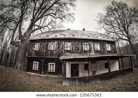 Abandoned old wooden house in dramatic light