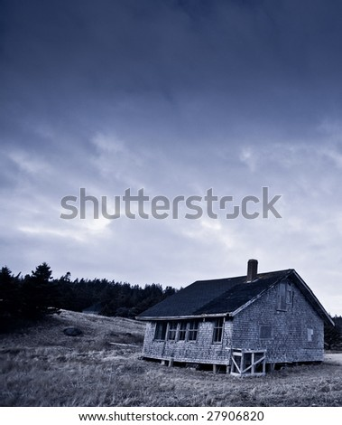 Abandoned old wooden schoolhouse in countryside. Photo taken at Yarmouth, Nova Scotia (Canada). - stock photo