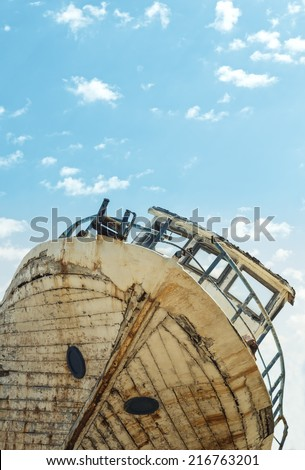 Abandoned old wooden shipwreck. - stock photo