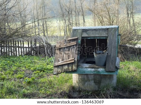 Abandoned old wooden well in western Ukrainian village - stock photo
