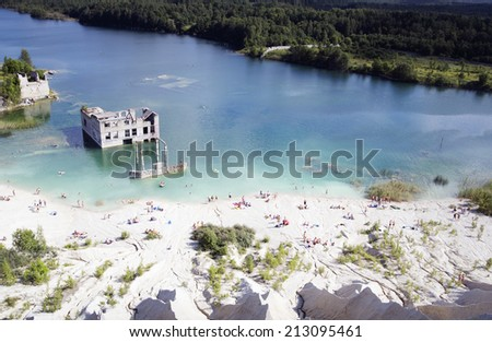 Abandoned open cast mine as popular swimming place - stock photo