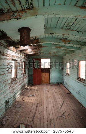 Abandoned Railroad Caboose Interior Western Ghost Town - stock photo