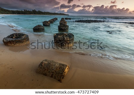 Abandoned remains of the old pier at Anahola Beach Park on the island of Kauai, Hawaii