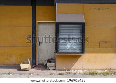 Abandoned restaurant with broken window